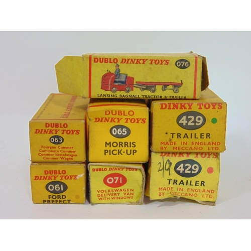 11 - Collection of small unboxed Dinky toy vehicles including recovery trucks, lorries, trailers, motorcy...