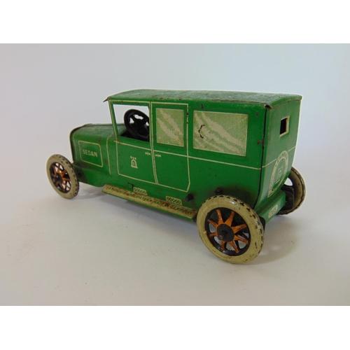 5 - A Lehmann tinplate clockwork Sedan car no 765 by Lehmann, in green, with a matching  Lehmann garage ...
