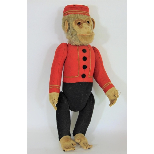 1 - Schucco Bellhop Yes/ No monkey C1920's with brown glass eyes, fur head, felt face, in red and black ...