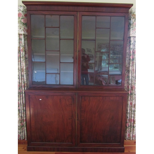 2556 - A good quality Georgian mahogany library bookcase, the lower section enclosed by two panelled doors ...