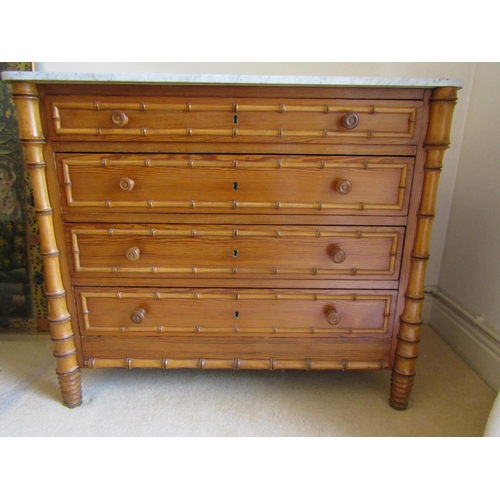 2651 - A matched pair of 19th century continental pine and beechwood chests of four drawers, with faux bamb...