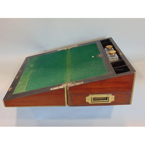 19th century mahogany and brass inlaid writing slope, the lid enclosing a baise slope with glass ink bottles and fitted interior, 45cm, wide