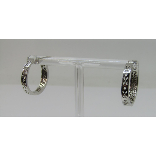 1313 - Pair of 9ct white gold hinged hoop earrings, pave set with diamonds, 5.9g total...