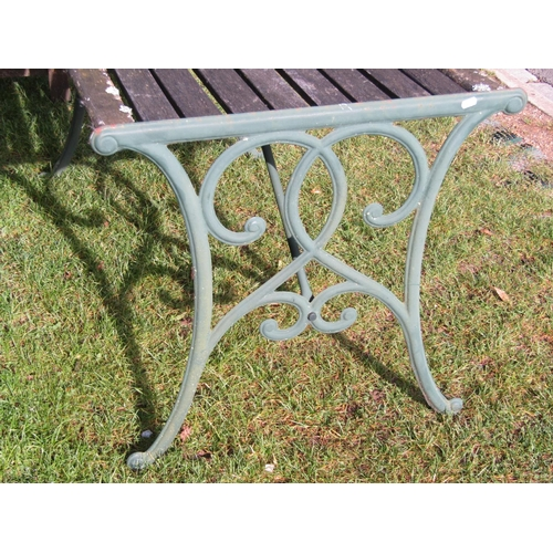 2040 - A contemporary but weathered garden table of rectangular form with slatted top raised on decorative ...