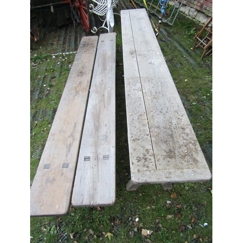 2056 - A weathered pine narrow tavern type table, the plank top with cleated ends raised on X framed suppor...