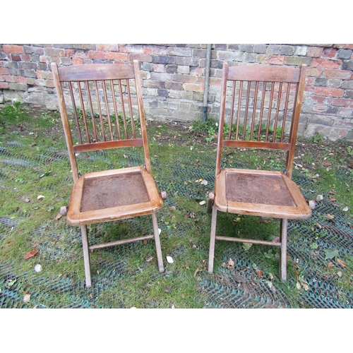 2058 - Forty eight vintage folding stained beechwood framed cafe chairs with stick backs and shell patterne...
