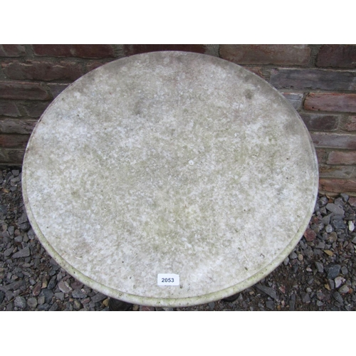 2053 - A cast iron pub table with fluted column and triform supports beneath a weathered circular white mar...