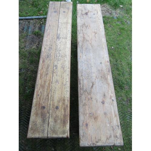 2054 - A pair of pine benches with rectangular plank seats, raised on shaped supports united by a chamfered...