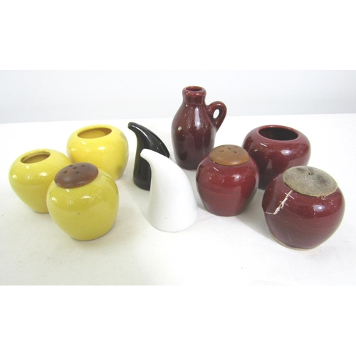 Kaj Franck for Arabia of Finland salt and pepper of stylised form, together with a further Swedish four piece and three piece cruet set in maroon and yellow (9)