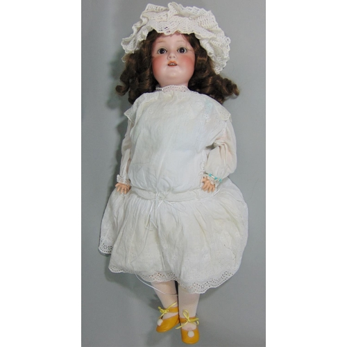 10 - CM Bergmann Waltershausen bisque socket headed doll, with fixed brown eyes, open mouth with top teet...