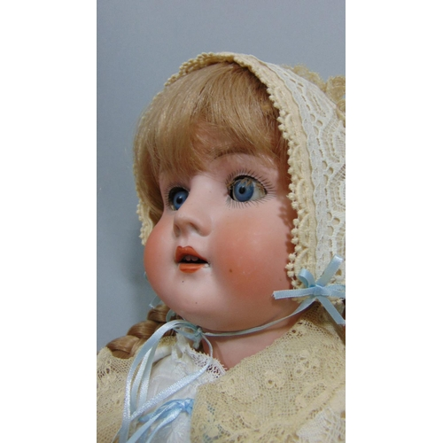14 - A Schoenau & Hoffmeister bisque socket head doll, with weighted sleeping blue eyes, long fair hair a...