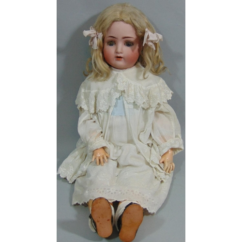 17 - German bisque head doll by Alt, Beck & Gottshalck with composition body with joined limbs, weighted ...
