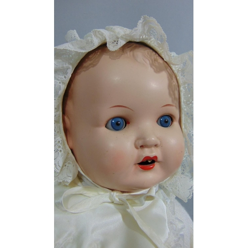19 - Four 20th century baby dolls including a 63cm tall doll marked Effanbee with composition head and lo...