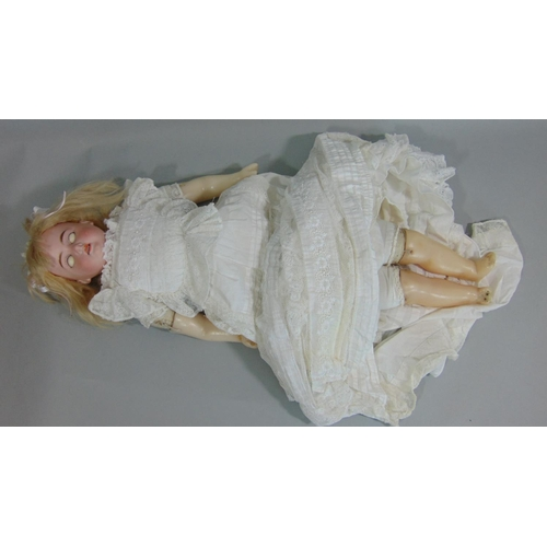 2 - Early bisque shoulder- headed doll by Armand Marseille with soft body and wax lower limbs, blue slee...