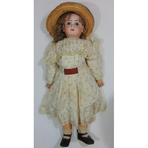 20 - Jumeau bisque head doll marked in red 'Depose Tete Jumeau 12' with fixed blue eyes, closed mouth, pi...