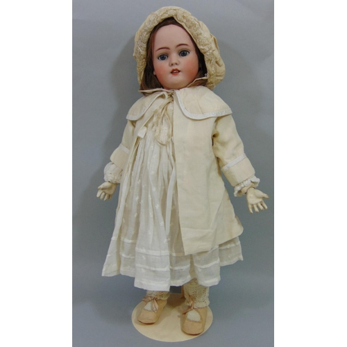 22 - Doll by Simon & Halbig with bisque socket head with jointed pale coloured composition body. weighted...