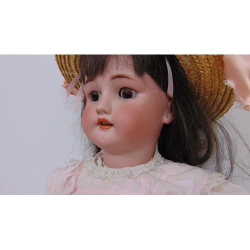 24 - Early 20th century doll with bisque socket head by Simon & Halbig for CM Bergmann, with jointed comp...