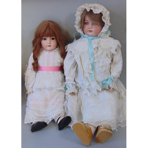 25 - 2 early 20th century dolls both with bisque socket heads and jointed composition bodies wearing peri...