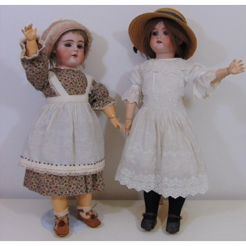 27 - 2 early 20th century bisque socket head dolls, both approx 55 cm tall with jointed composition body,...