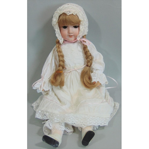 3 - Armand Marseille doll mould 390 with a bisque socket head and with stick legs on a jointed compositi...