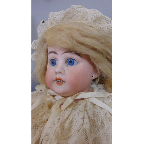 31 - 2 circa 1920's bisque head dolls both with jointed composition bodies, fixed blue eyes,open mouth an...