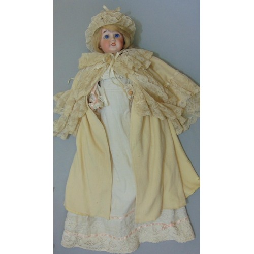 31 - 2 circa 1920's bisque head dolls both with jointed composition bodies, fixed blue eyes, open mouth a...