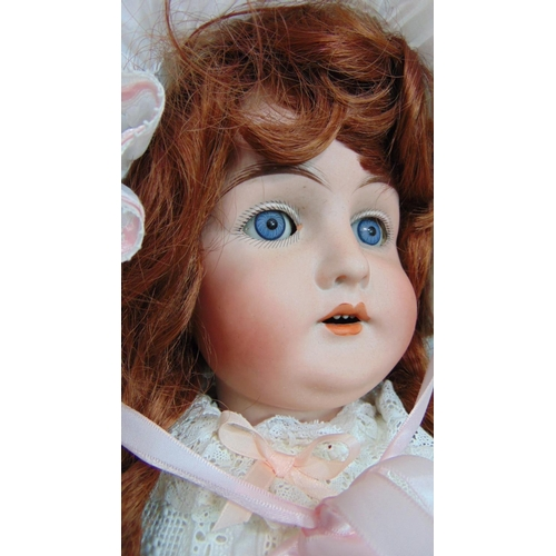 34 - A Karl Hartmann  bisque head doll (1911-1926) with blue closing eyes, open mouth with teeth, long au...