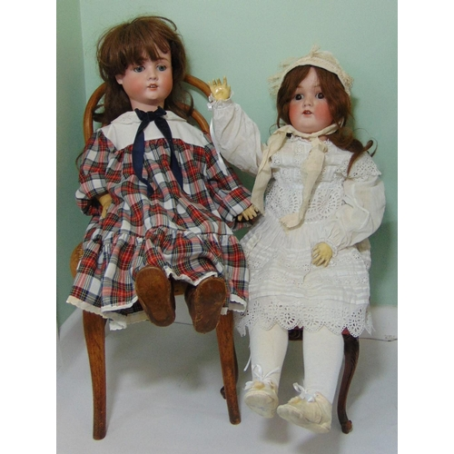 35 - 2 German bisque head dolls with jointed composition bodies; taller doll height 78cm has closing brow...