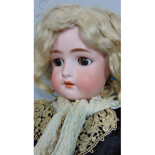 36 - Bisque head doll by Kammer & Rheinhardt with composition jointed body, sleeping brown eyes, pierced ...