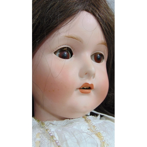 5 - A CM Bergmann Waltershausen bisque headed doll, having fixed brown eyes, open mouth with top teeth s...