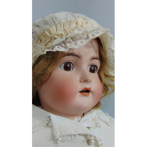 6 - 1920's bisque headed doll by Simon & Halbig for Kammer & Rheinhardt, impressed '80' with brown hair,...
