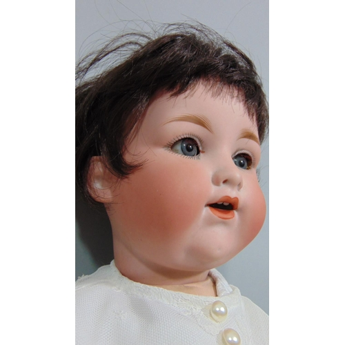 9 - 1920's Armand Marseille Baby Doll with bisque socket head and composition body with bent limbs. Blue...