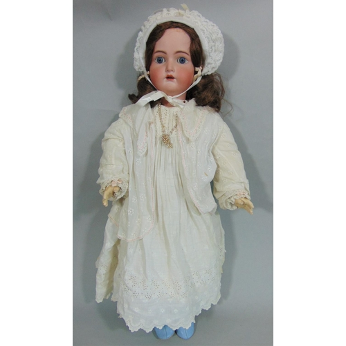 40 - Bisque head doll by Kammer & Rheinhardt with composition jointed body, fixed blue eyes, open mouth w...