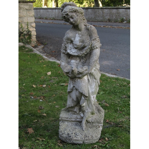 2011 - A weathered cast composition stone garden figure group in the form of a romantic couple, 70 cm high,...