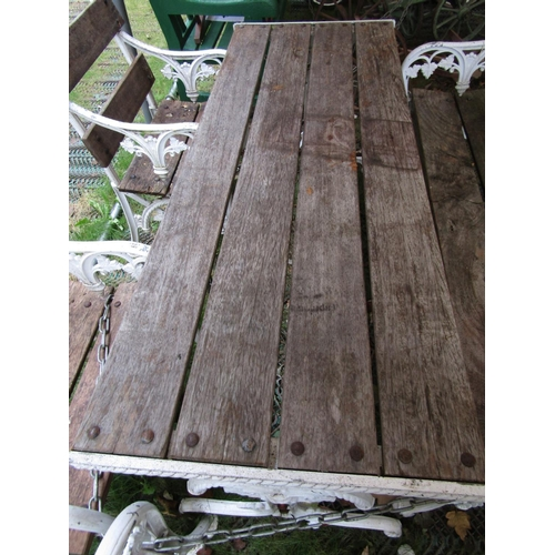 2048 - A good quality five piece garden suite in the Coalbrookdale manner, comprising rectangular table, be...