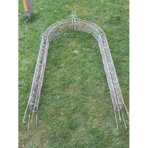 2050 - A galvanised steel rose arch/arbour with decorative lattice and scroll detail, 265 high x 120cm wide...