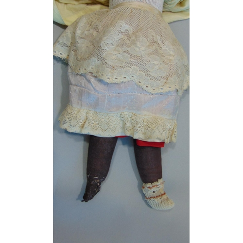 41 - French shoulder head bisque doll by Laternier with soft stuffed body and legs, and bisque lower arms...