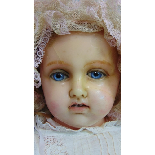 44 - 19th century wax over composition shoulder head doll with stuffed soft body and hollow wax lower lim...