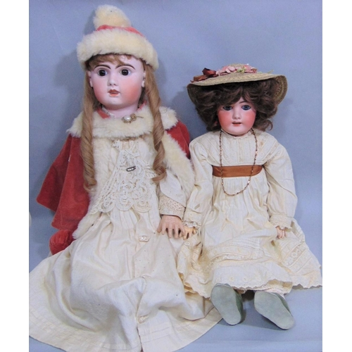 47 - 2 large well dressed bisque head dolls with jointed composition bodies, pierced ears, open mouth wit...