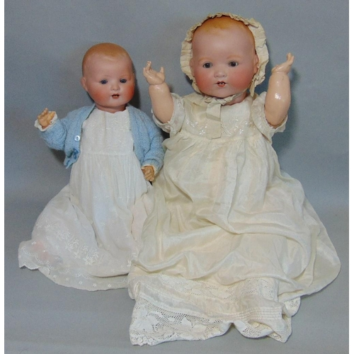 49 - 2 bisque head baby dolls Dream Babies both with composition bent limbs; the first has brown fixed ey...