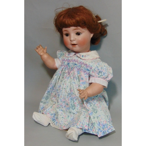 50 - Schoenau & Hoffmeister bisque head baby doll with brown closing eyes, open mouth with teeth, brown h...