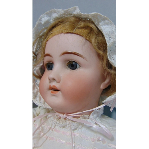 51 - 2 German bisque head dolls both with blue sleeping eyes, open mouth with teeth, short fair hair, wea...