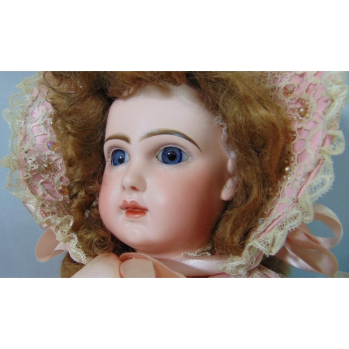 57 - Bisque head doll with faint Jumeau makers mark and number '8' in red; fixed blue eyes, closed mouth,...