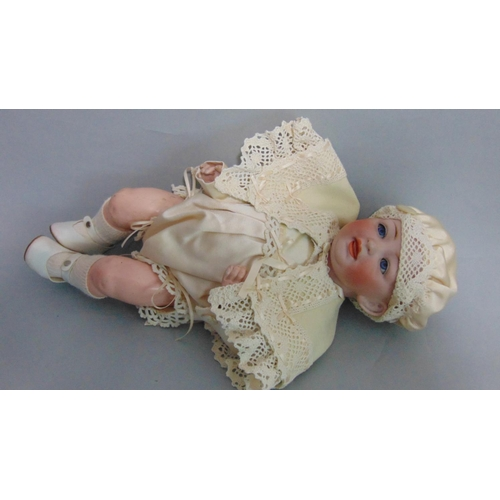 58 - Bisque head baby doll by Kestner, composition body with bent limbs, fixed blue eyes and open mouth, ...