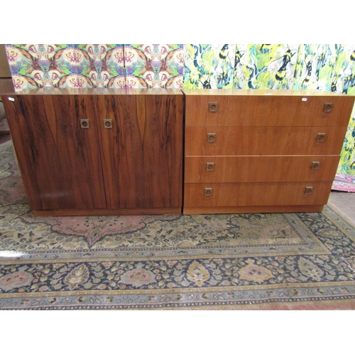736 - 1970s teak chest of four long drawers with brass drop handles, 70cm high x 88cm wide, together with ...