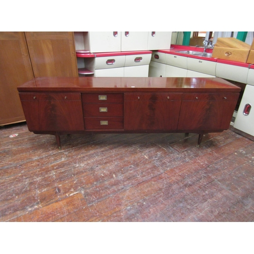 752 - Unusual mahogany Danish style sideboard fitted with three drawers, fall front door and two cupboard ...