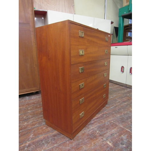 754 - 1970s teak secretaire chest, fall front enclosing fitted interior over four long drawers fitted with...