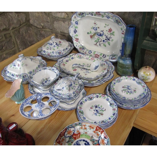 1003 - A collection of Coronaware Old Woodstock pattern dinnerwares comprising a pair of tureens and covers...