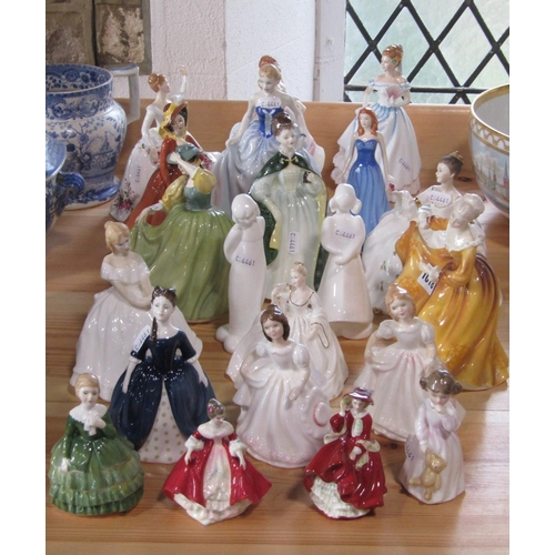 1018 - A collecton of 20 Royal Doulton figures of female characters including Kirsty HN2381, Premiere HN234...
