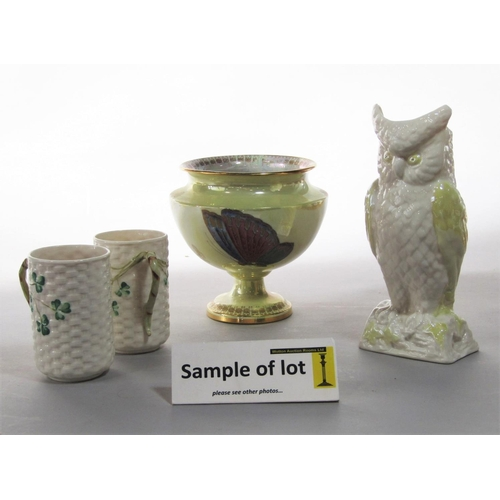 1022 - A Belleek vase in the form of an owl, a pair of Belleek mugs with basket weave and Shamrock moulding...